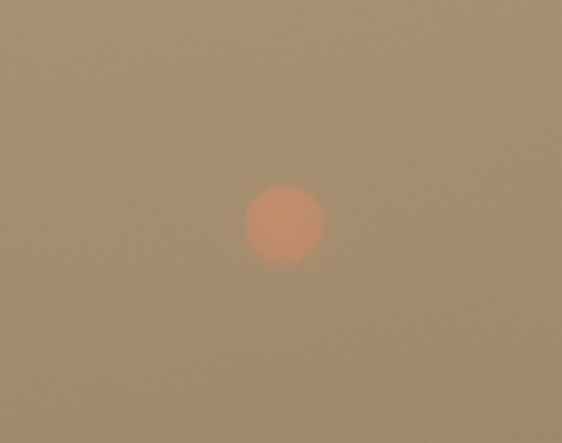 Red Sun in Dusty Sky